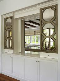 Kitchen Pass Through Window by Kitchen Pass Through With Octagon Mirrored Cabinets Transitional