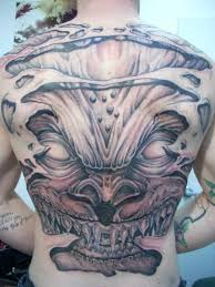 men full back decorated with ultimate demon face tattoo design