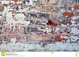 old layers of colorful peeling paint on exterior brick stock photo
