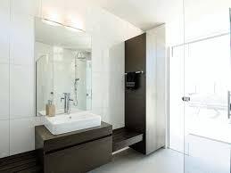 big white bathroom tiles oval shaped metal console sink fancy