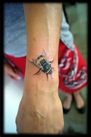 Tattoo On Top Of Wrist | color realism portraiture bumblebee top of wrist tattoo