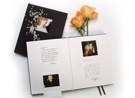 polaroid guest book album newlyweds leave their reception with their wedding album in