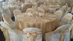 discount linen rentals soft gold shantung tablecloths and chair sashes ivory polyester