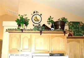 ideas for tops of kitchen cabinets above kitchen cabinet decor ideas kgmcharters com