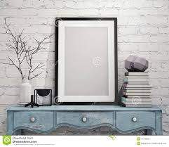 mock up poster frame on vintage chest of drawers interior stock