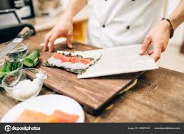 japanese restaurant cook at table male cook making sushi wooden table traditional japanese cuisine