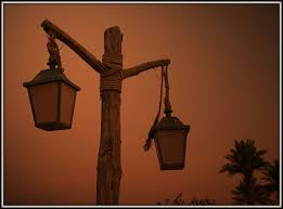 maybe industrial lamps hanging and maybe just using one instead of