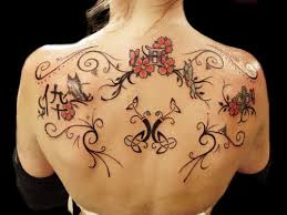pretty tribal flower tattoos on back tattoo design ideas