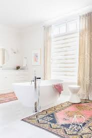 Pink Bathroom Rug by Rosenheck White Bathroom With Center Of The Room Tub And Pink And