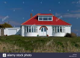 bungalow with red roof uk stock photo royalty free image