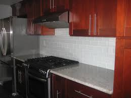 glass wall tile and off white glass subway tile kitchen backsplash