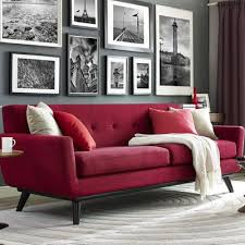 Living Room With Red Sofa by Tribecca Home Knightsbridge Tufted Scroll Arm Chesterfield Sofa
