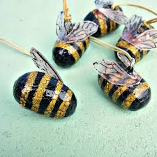 set of five crackled papier mache bumble bee ornaments on cord