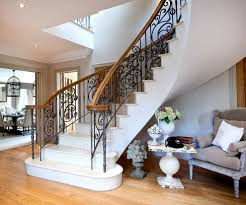 curved staircase entry decorating staircase beach style with wood