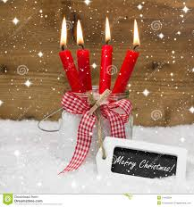 snowy merry christmas four red burning candles with bow and me