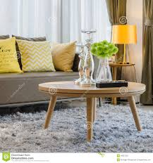 wooden round table on carpet in living room stock photo image royalty free stock photo download wooden round table on carpet in living room