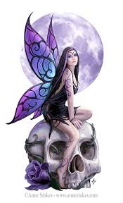 fairy holding skull tattoo design photos pictures and sketches