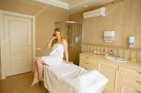 in the massage room sits on the massage table u2014 stock photo
