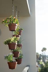 how to turn your clay pots into a vertical garden the horticult