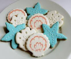 seashell shaped cookies decorated sugar cookies royal icing white pink orange