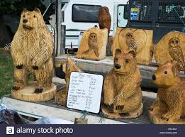 chainsaw wood carvings for sale stock photo royalty free image