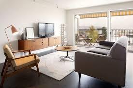 elegant gray paint wall wooden base legs mid century modern living