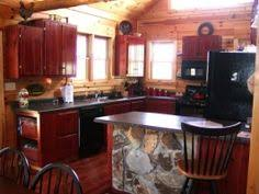 Log Cabin Kitchen Cabinets by Red Cabinetry Ads Fun And Color To This Log Cabin Kitchen
