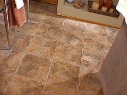 How To Tile Kitchen Floor by How To Install Snap Together Tile Flooring Diy Network Tile