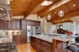 open concept kitchen with vaulted wood ceiling transitional