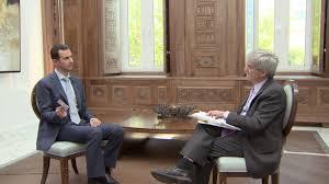 exclusive defiant assad tells yahoo news torture report is u0027fake