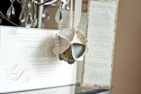 ornament made from wedding invitations united with
