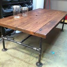 wood and pipe table custom made barn wood cast iron pipe coffee table by j s reclaimed