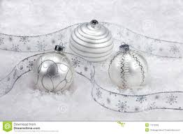 White Silver Christmas Decorations by Three White And Silver Christmas Ornaments On Snow Stock Photos