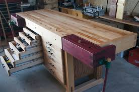 beautiful modified roubo workbench with tool storage