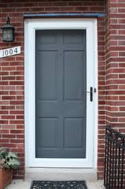 exterior color scheme for red brick and gray roof teal door