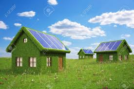 solar panels on roof houses from the grass with solar panels on the roof stock photo
