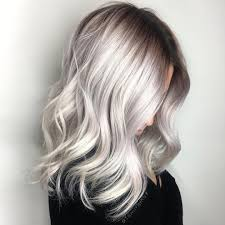 platinum hairstyles with some brown large waves blonde platinum silver hair with wavy curls and