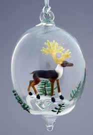 made reindeer and snowy trees blown glass ornament by