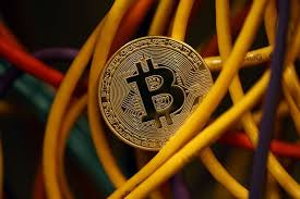 what is a bitcoin how much is it worth is it safe how do i get