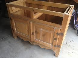 mothering with creativity diy kitchen island from an old armoire while the cracks in the back wouldn t have been an issue for an armoire for a kitchen island