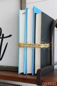 how to use books in your home decor the summery umbrella there are so many different and interesting ways you can use books in your home decor