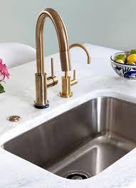 delta trinsic faucet in champagne bronze kitchen by design