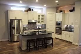 white painted kitchen cabinets with black counter tops and