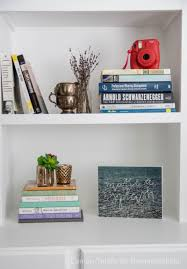 remodelaholic afternoon bookshelf refresh with diy paper book covers