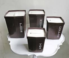 vintage kitchen canister set four brown white lettering plastic
