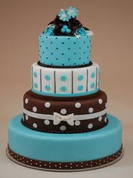 four tier chocolate brown and blue fondant wedding cake decorated