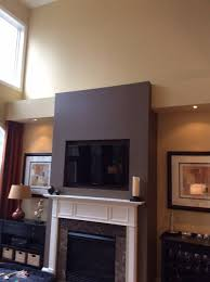 one side of the built in would be av equipment cabinet and the other a cabinet a bar area with floating shelves above any thoughts