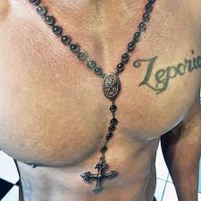 black rosary around neck and on chest for