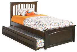 varnished dark walnut wood single size trundle bed with orange