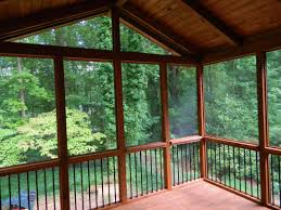 interior of screened in porch with trex decking and azek trim
